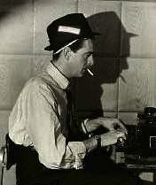 Old-school reporter typing